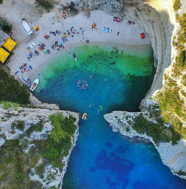 Stiniva beach on Vis island looks like a keyhole from air